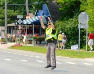 4th of July_Glen Arbor_officer Clint Kerr_directing parade