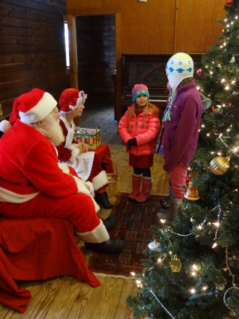 santa and mrs clause_at the 2014 holiday marketplace in glen arbor