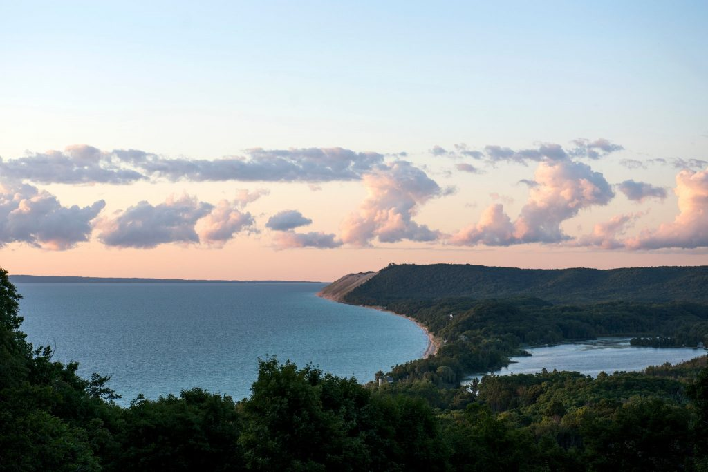 Spectacular aerial view of summer sunset looking over the bluffs of the sleeping bear dunes national lake shore in Empire Michigan