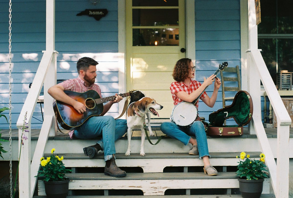 photo of musicians on porch with dog: Chatham Rabbits