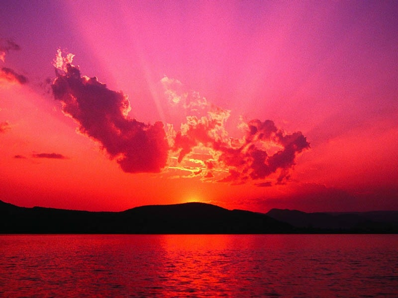 vibrant pink and purple sunset over glen lake