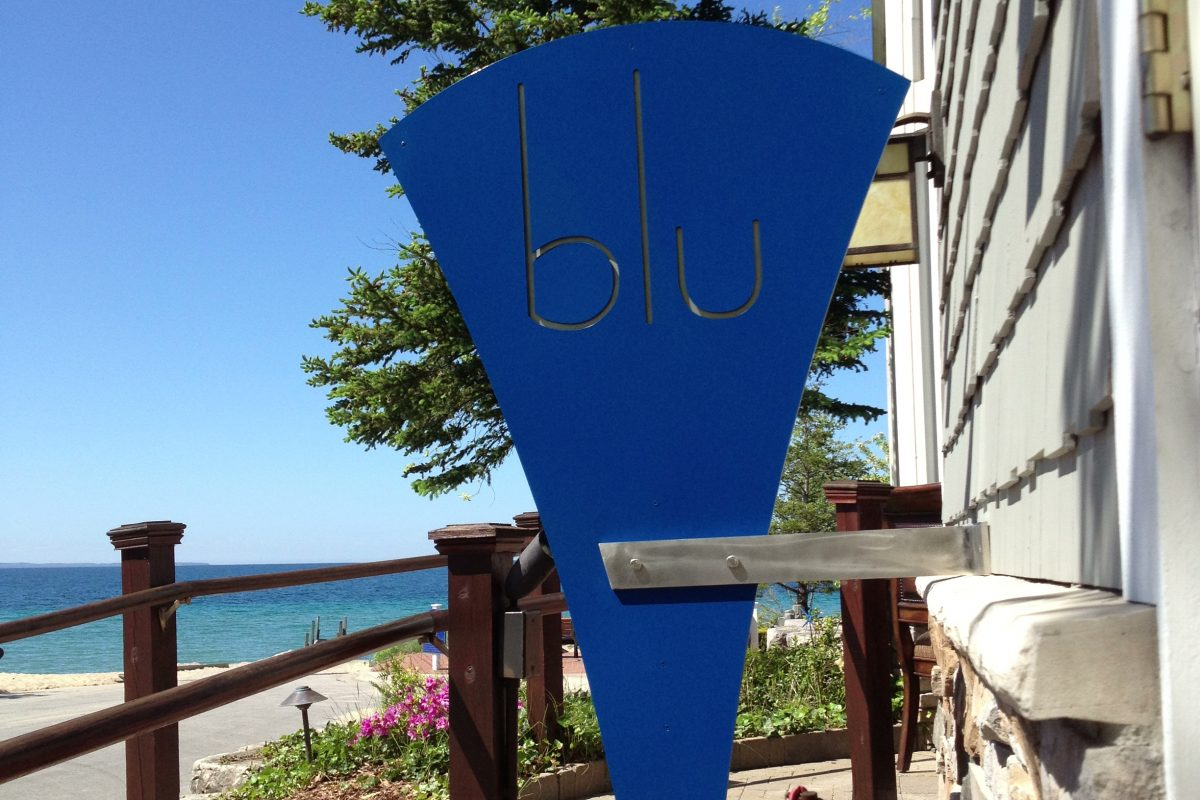 Blu sign on side of building
