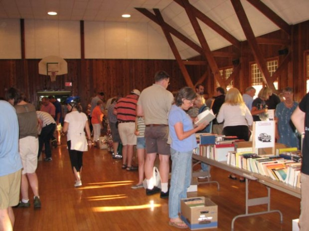 people shopping at book sale in town hall