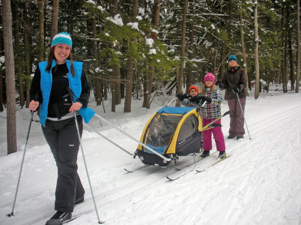 Two women and three kids skiing cross country on the Sleeping Bear Dunes Heritage Trail