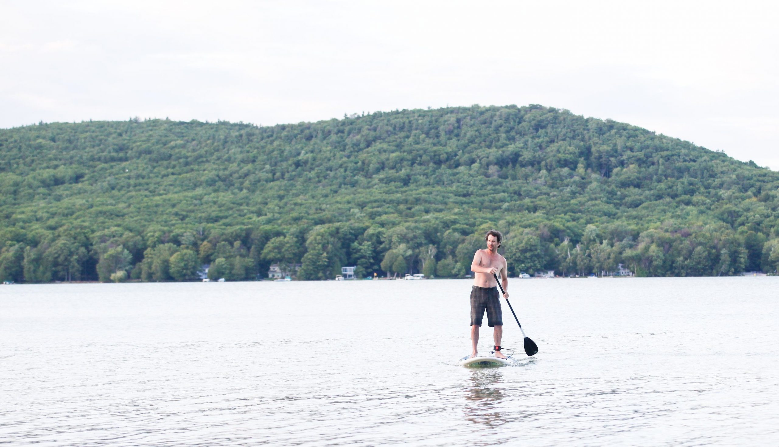man paddle boarding on lake