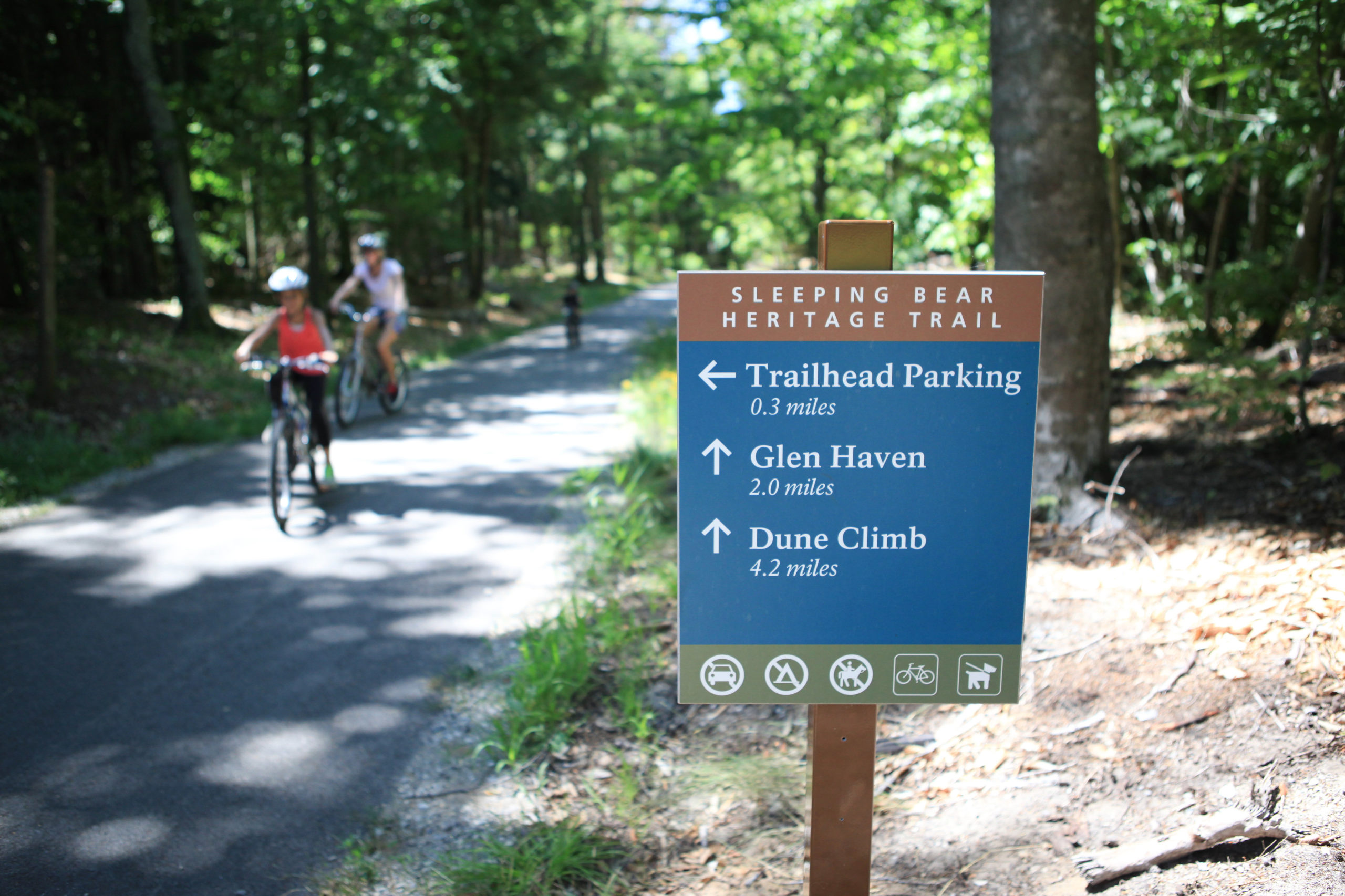 sleeping bear heritage trail sign with bikers