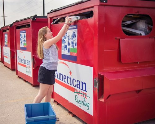 woman dropping off recycling at American Waste containers