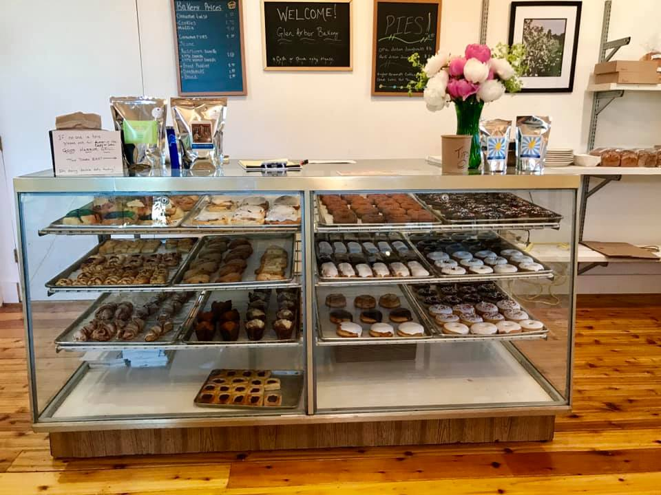 Glen Arbor Bakery display case with rows of donuts and pastries