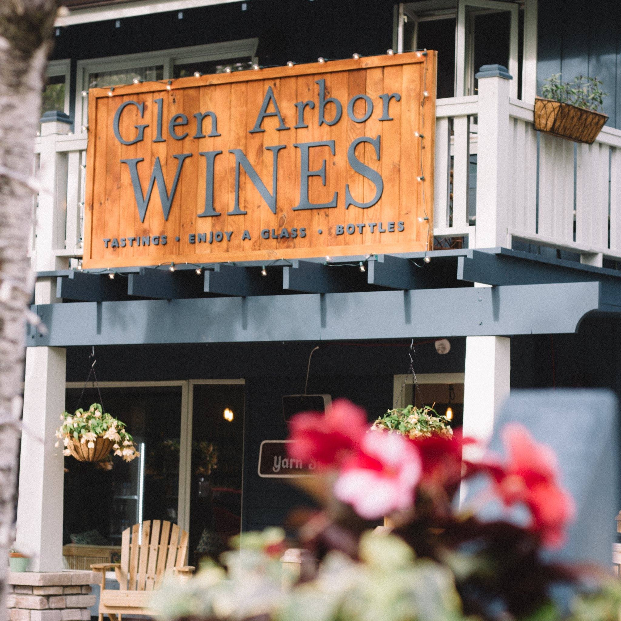 storefront sign at Glen Arbor Wines on Lake Street north of M22