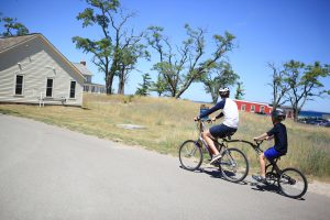 father and son biking the heritage trail at historic glen haven