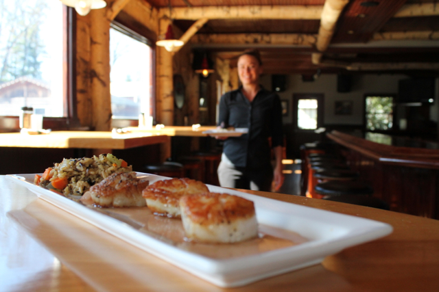 waitress serving dinner, close up food photo; Restaurant Week Glen Lake, MI event