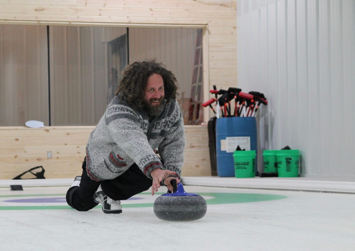 Owner David Gerenson curling at Leelanau Curling Club in Maple City
