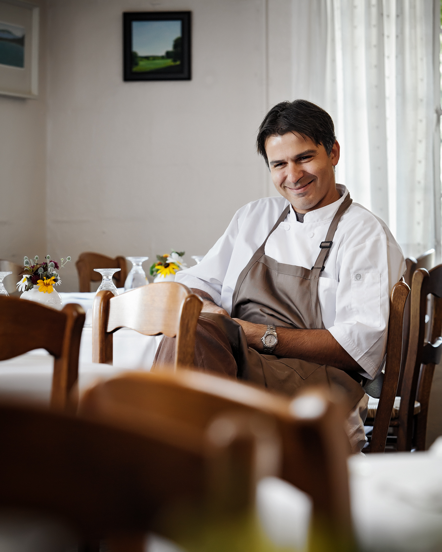 chef at La Becasse sitting and smiling