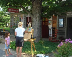girl watching woman plein air paint