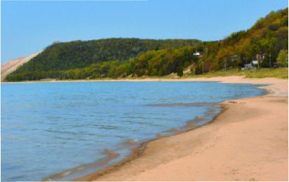 dune and beach view by Northland Vacation Rentals