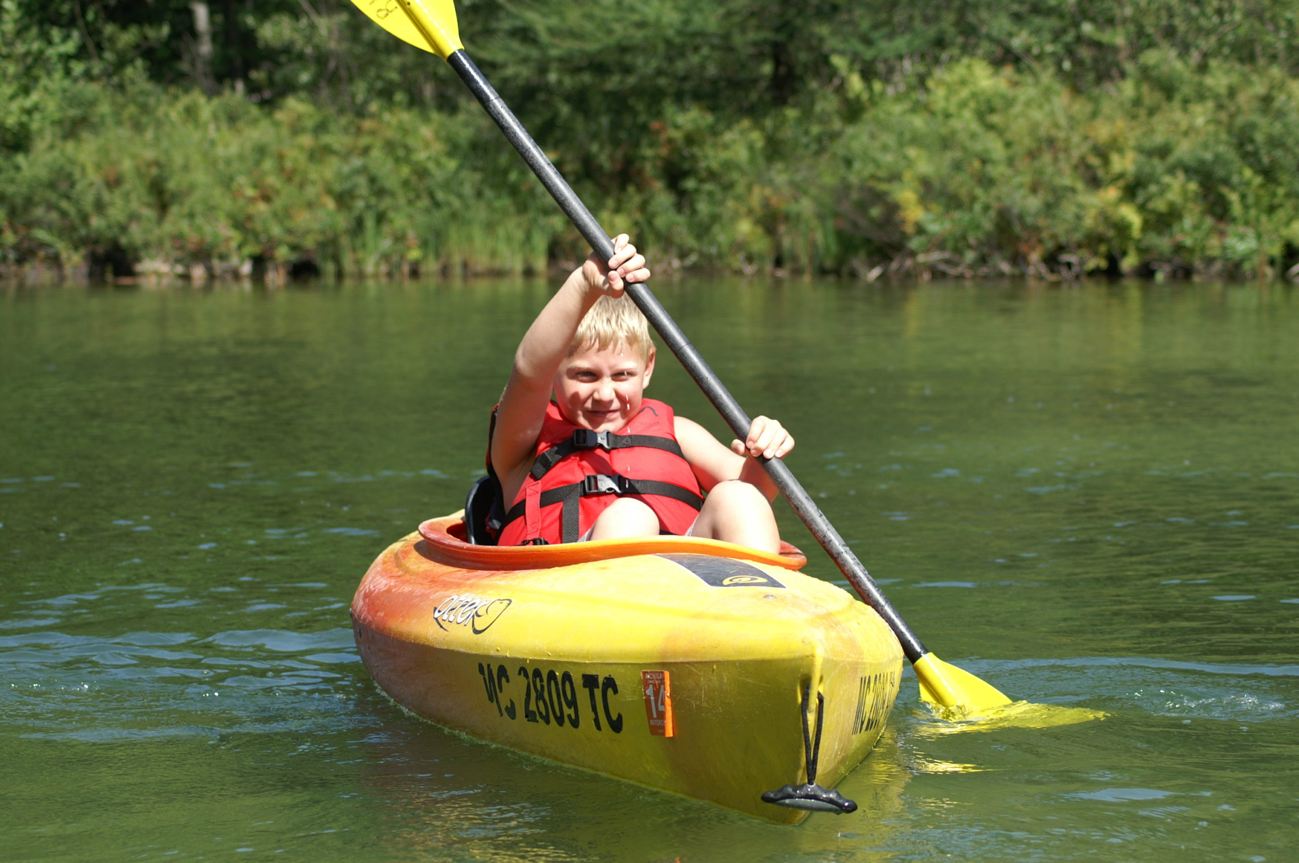 child kayaking