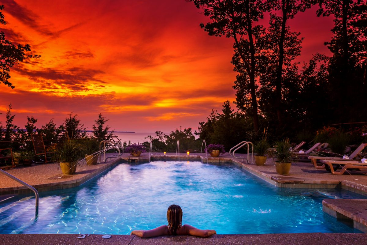 luxurious sunset view of pool overlooking lake at Spa Amira