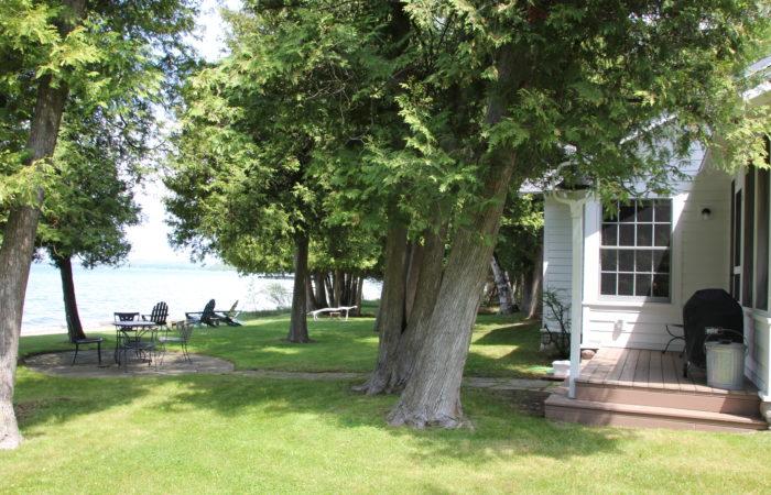 Sunset Shore lakeside cottage yard view