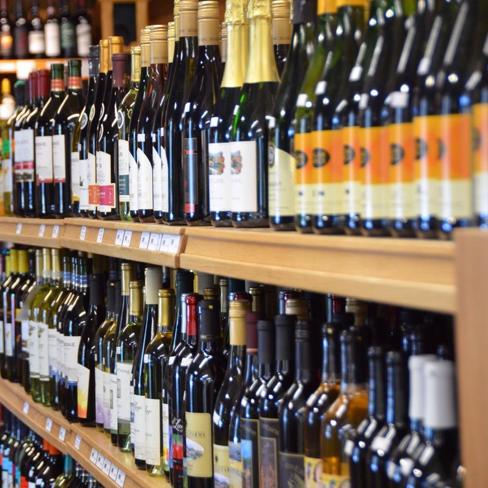 close up of wine bottles on shelves