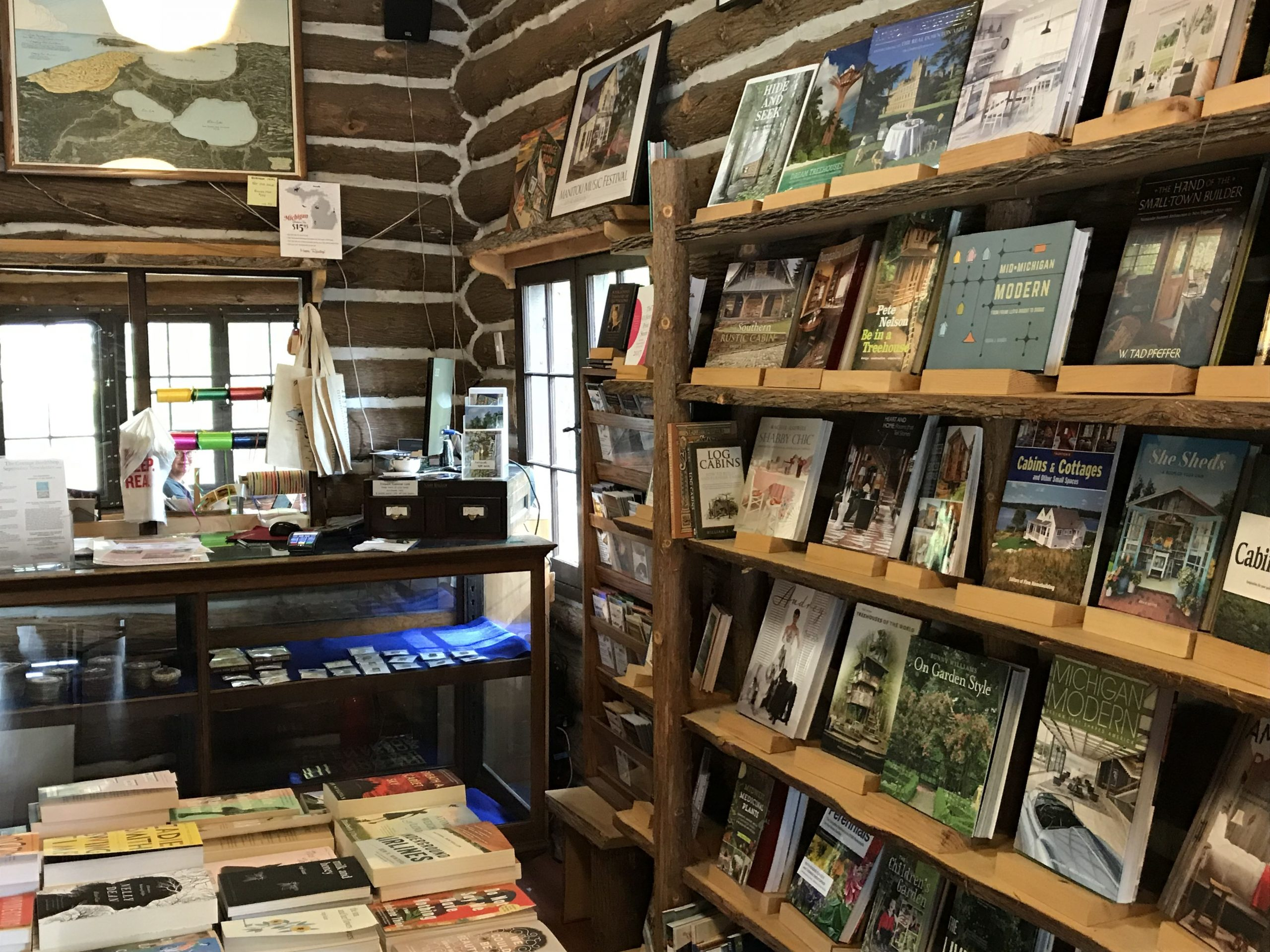The main room of The Cottage Book Shop with shelves and tables filled with books from which to choose.