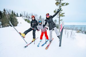 Mom and kids ski atop the homestead resort
