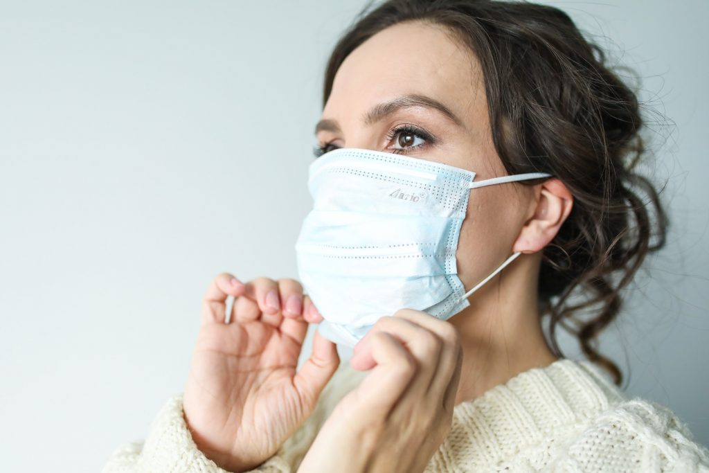 Woman in a white face mask during the coronavirus pandemic