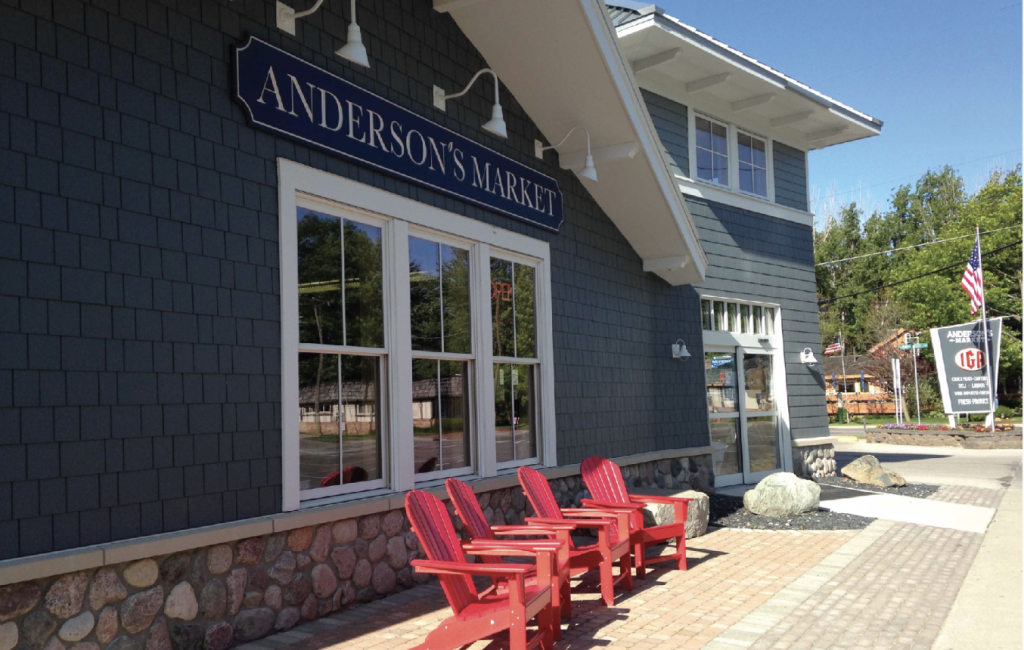 comfortable seating in red adirondack chairs in front of Anderson's Glen Arbor Market