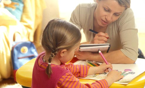 woman providing in home childcare stock photo