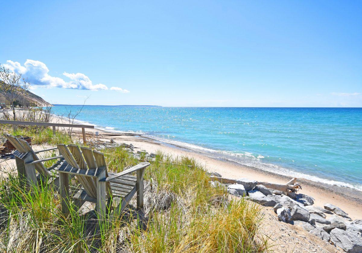 dune grass Adirondack chairs on lake michigan beach