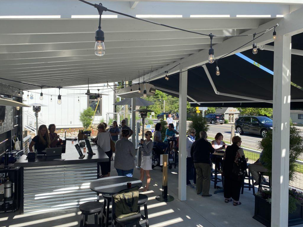 people on the m22 wine patio in Glen Arbor
