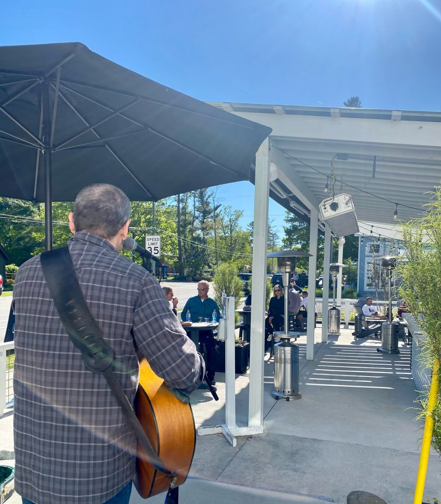 Andre Villoch playing live music on m22 wine patio in Glen Arbor